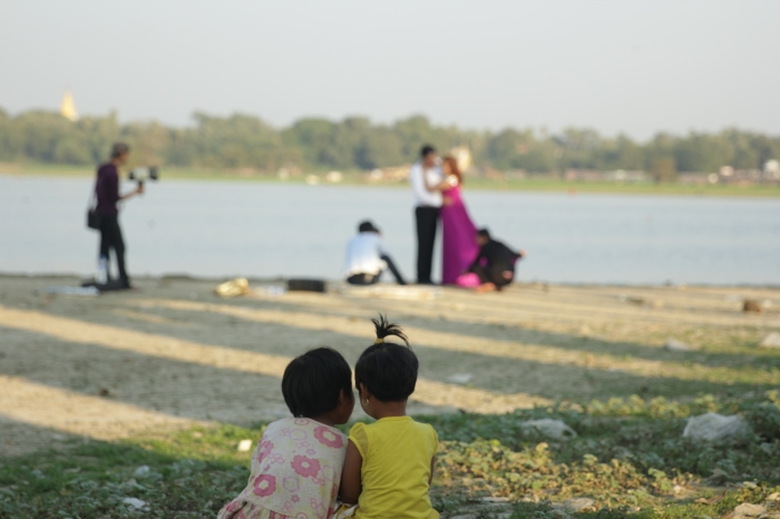 I took this photo by a lake in Mandalay. These girls live in a tent under a bridge nearby.